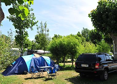 Car and tent on a campsite in Vendée